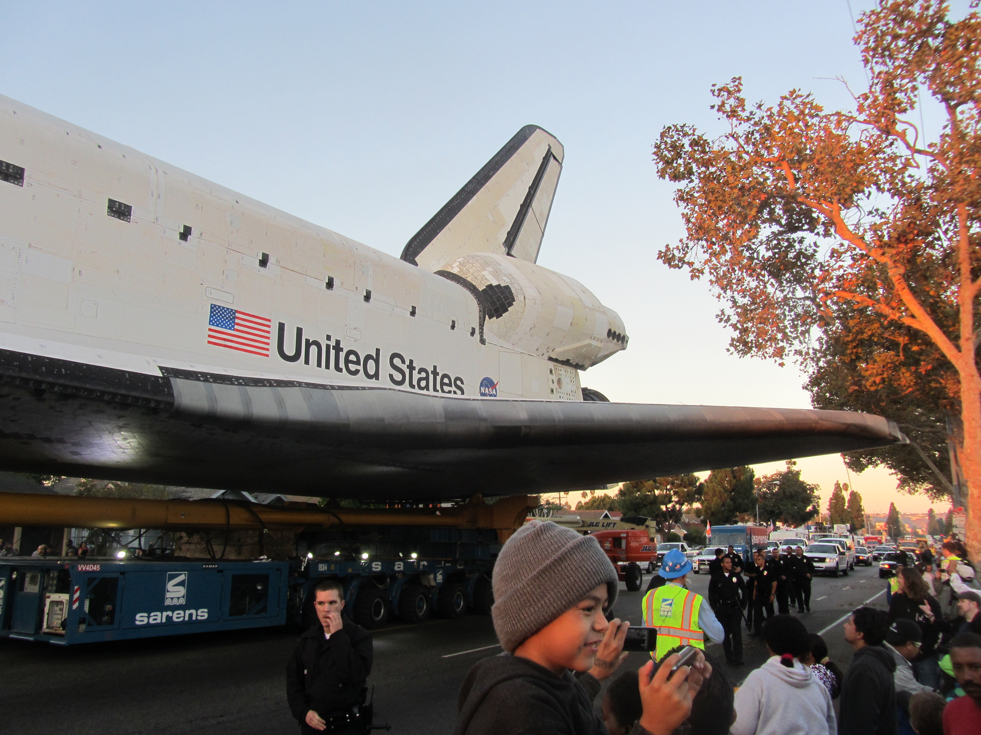 Shuttle Endeavour's Wing Glides Over Crowd