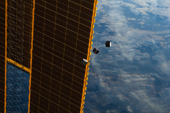 Several tiny satellites float in front of the ISS in this image by an Expedition 33 crew member from the International Space Station. This image was taken Oct.4, 2012.