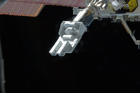 Small Satellite Orbital Deployer (SSOD) attached to the Japanese module's robotic arm is featured in this image photographed by an Expedition 33 crew member on the International Space Station. Several tiny satellites were released outside the Kibo laboratory using the SSOD on Oct. 4, 2012.