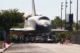"Space shuttle Endeavour is seen approaching the California Science Center at the end of its three-day, 12-mile (19 km) ""Mission 26"" road trip, Oct. 14, 2012."