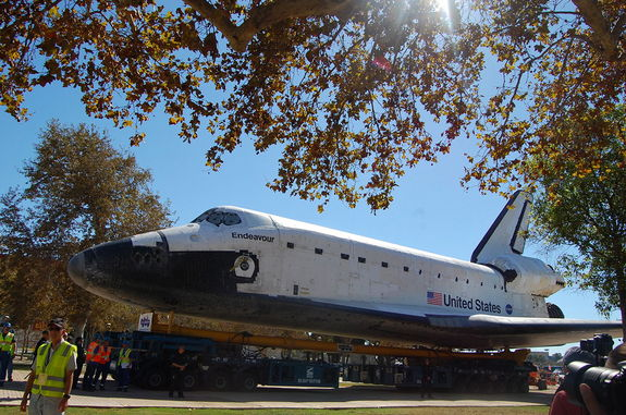 "Space shuttle Endeavour rolls toward its new display pavilion at the California Science Center in Los Angeles in the final stretch of its three-day, 12-mile (19 km) ""Mission 26"" journey."