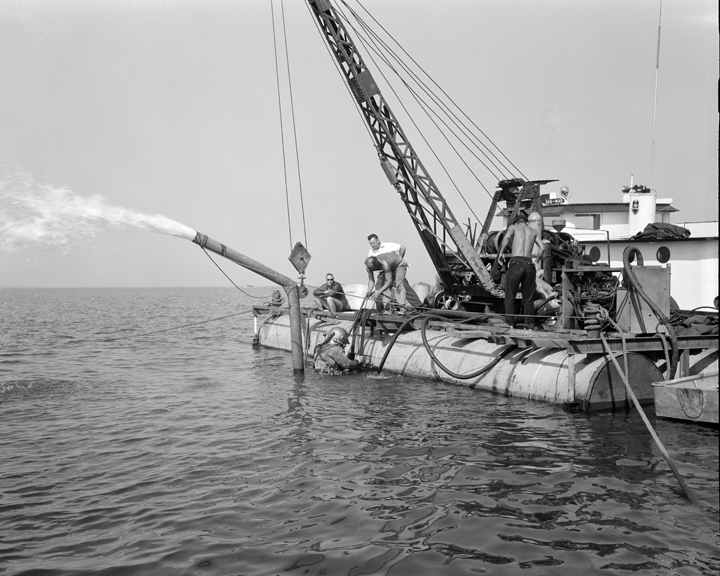 Space History Photo: Divers Clear Submerged Water Pumps