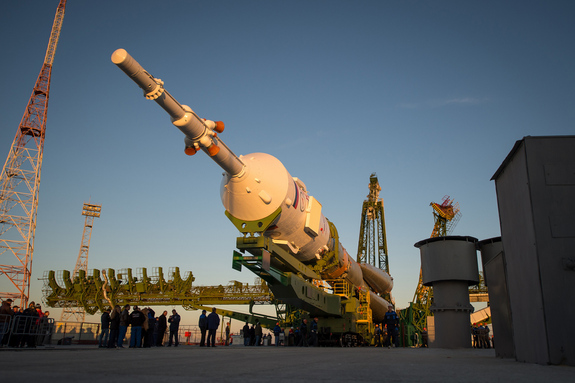 The Soyuz rocket is ready to be erected into position after being rolled out to the launch pad by train, on Sunday, October 21, 2012, at the Baikonur Cosmodrome in Kazakhstan. Launch of the Soyuz rocket is scheduled for October 23 and will send Expedition 33/34 Flight Engineer Kevin Ford of NASA, Soyuz Commander Oleg Novitskiy and Flight Engineer Evgeny Tarelkin of ROSCOSMOS on a five-month mission aboard the International Space Station.