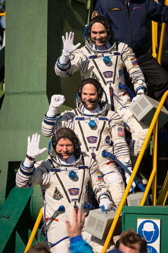 Expedition 33/34 crew members, Soyuz Commander Oleg Novitskiy, bottom, Flight Engineer Kevin Ford of NASA, and Flight Engineer Evgeny Tarelkin of ROSCOSMOS, top, wave farewell before boarding their Soyuz rocket just a few hours before their launch to the International Space Station on Tuesday, October 23, 2012, in Baikonur, Kazakhstan.
