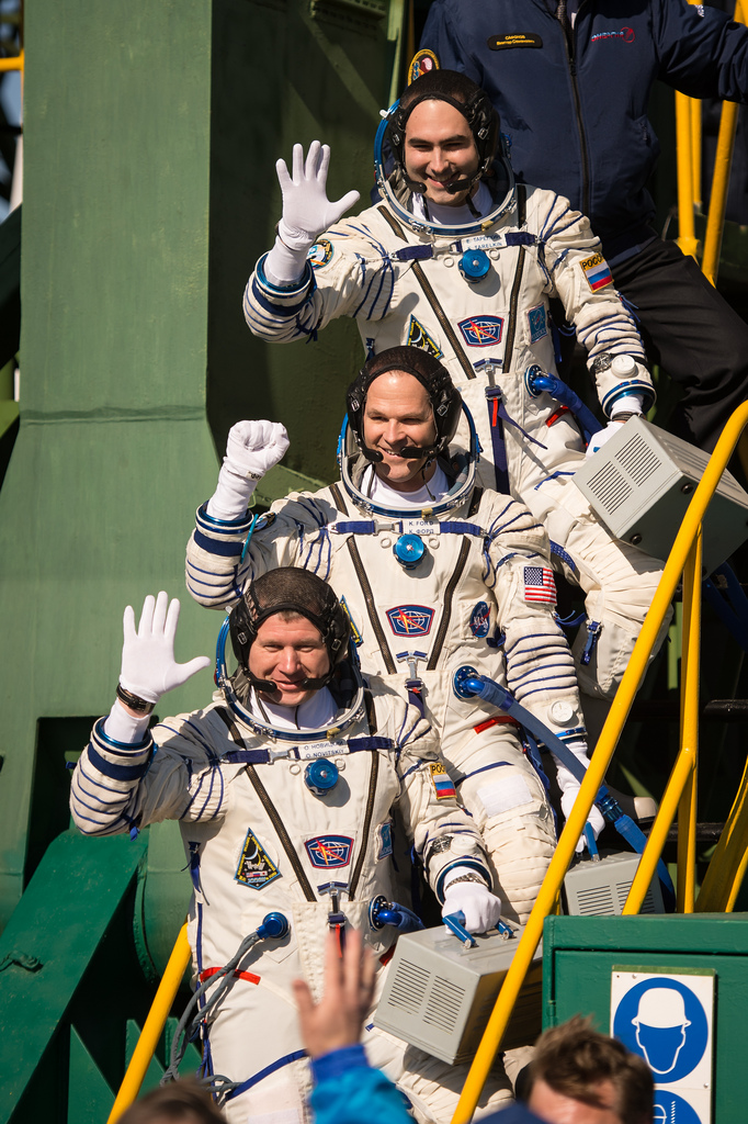 Expedition 33/34 Soyuz Crew Waves at Launch Pad