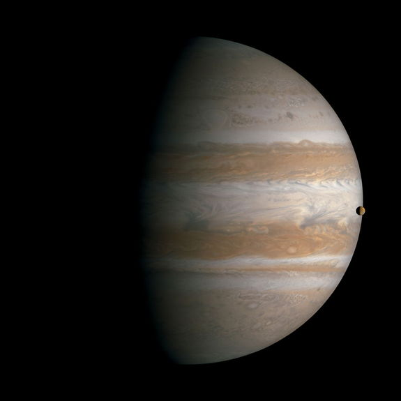 Transit of Io across Jupiter. South is up in this view. Mosaic composite photograph. Cassini, January 1, 2001.