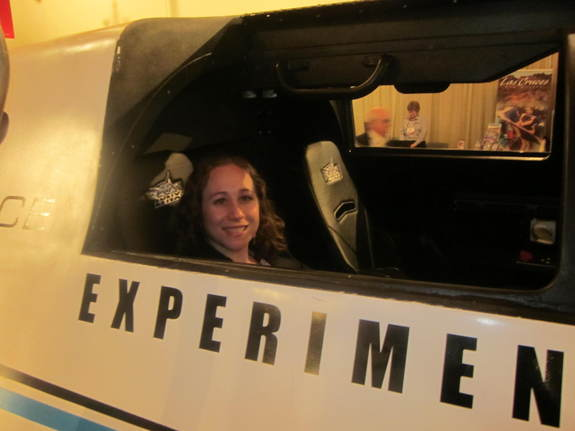 SPACE.com reporter Clara Moskowitz sits inside a mockup of the XCOR Lynx suborbital spaceship.