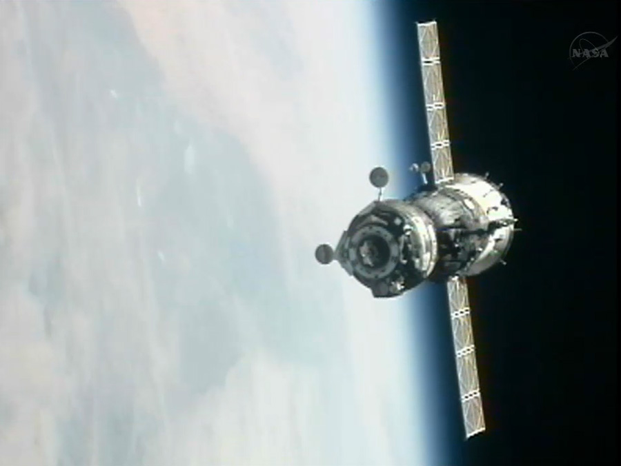 Soyuz Spacecraft Docks at Space Station with New US-Russian Crew