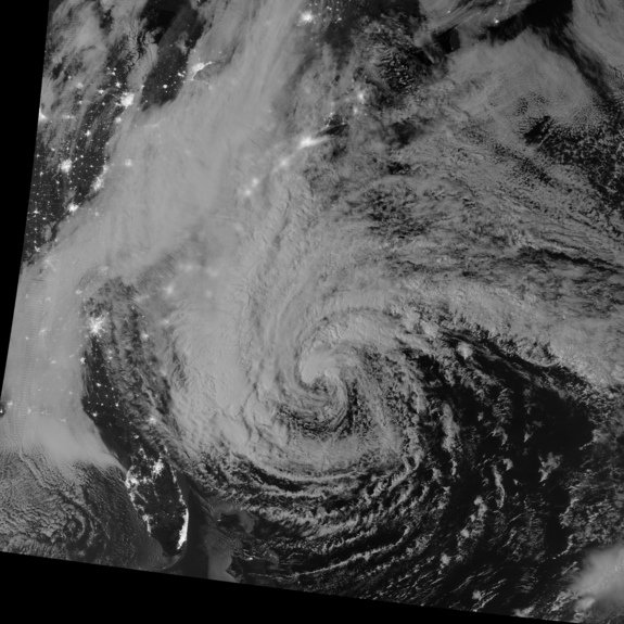 This night-view image of Hurricane Sandy was acquired by the Visible Infrared Imaging Radiometer Suite (VIIRS) on the Suomi NPP satellite around 2:42 a.m. Eastern Daylight Time (06:42 Universal Time) on October 28, 2012. In this case, the cloud tops were lit by the nearly full Moon (full occurs on October 29). Some city lights in Florida and Georgia are also visible amid the clouds.