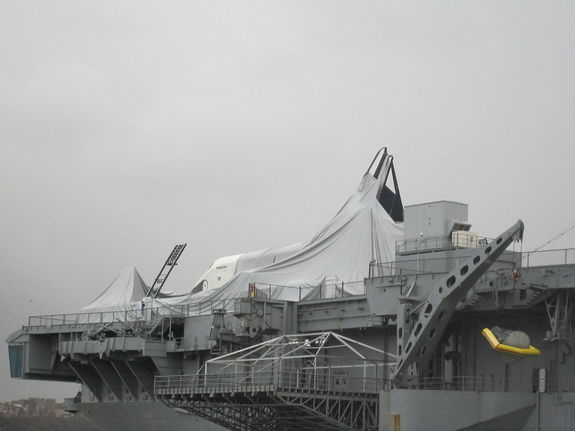 Space shuttle Enterprise is seen after Hurricane Sandy at the Intrepid Sea, Air and Space Museum in New York on Oct. 30, 2012. Photos show the shuttle's protective shelter has collapsed and the orbiter has incurred some damage.