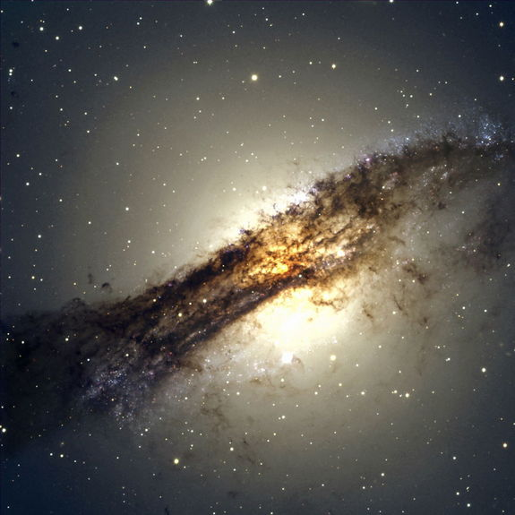 The giant elliptical galaxy Centaurus A shows a split personality because it hides a gaseous spiral at its core. When Centaurus A collided with a spiral galaxy 300 million years ago, it slurped up the spiral's gases, which formed a new spiral inside the larger galaxy. Image released Oct. 22, 2012.