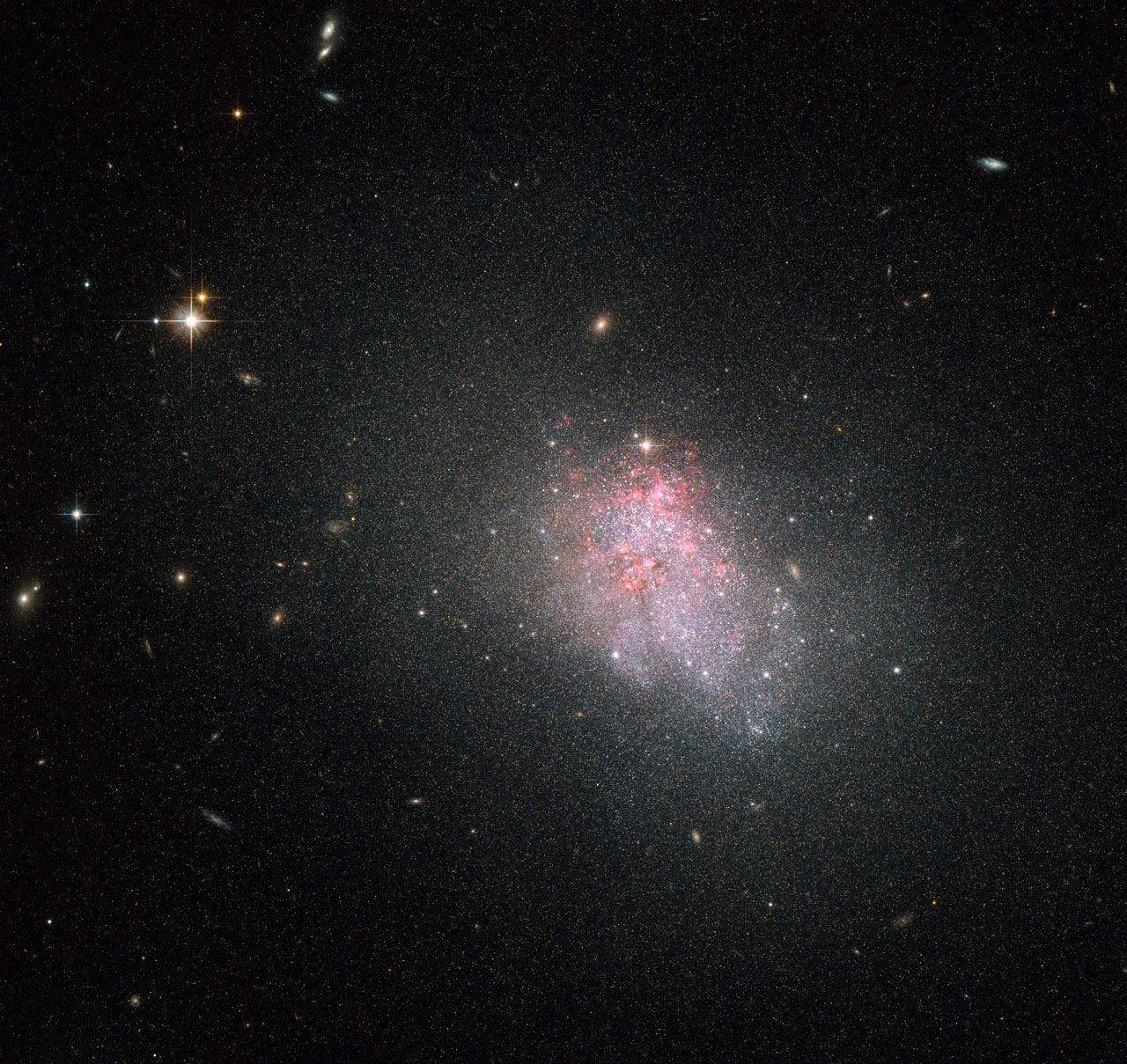 Dwarf Galaxy Churns out New Stars in Hubble Photo
