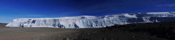 Kimberly Casey, a glaciologist based at NASA's Goddard Space Flight Center, snapped this panoramic image of Kilimanjaro's northern ice field in September 2012. For scale, bright tents that were part of the scientists' base camp are just barely visible in the lower left of the northern ice field image.
