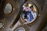 Sir Richard Branson and daughter, Holly, look through the window of a SpaceShipTwo shell. Image released Nov. 12, 2012.