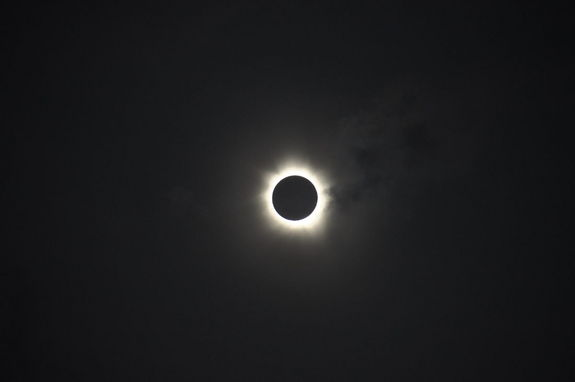 The total solar eclipse of November 13-14,2012. The clouds cleared in time for observers at Palm Cove, Australia, to experience totality as the Moon totally obscured the Sun for around two minutes, revealing the Sun's bright corona.