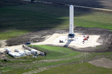 Grasshopper consists of a Falcon 9 rocket first stage, Merlin 1D engine, four steel landing legs with hydraulic dampers, and a steel support structure. For a sense of its scale, note the blue pick-up truck to the left of Grasshopper in the photo above.