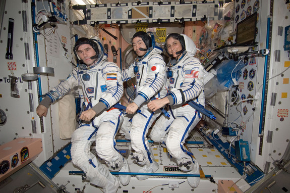 n the International Space Station's Unity node, NASA astronaut Sunita Williams, Expedition 33 commander; along with Japan Aerospace Exploration Agency astronaut Aki Hoshide (center) and Russian cosmonaut Yuri Malenchenko (left), both flight engineers, attired in their Russian Sokol launch and entry suits, take a moment for a photo as they prepare to perform the standard leak check in their spacecraft in preparation for their return to Earth on Nov. 18, 2012.