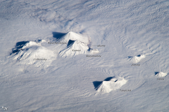 Astronauts aboard the International Space Station captured this oblique view of the snow covered peaks of the volcanoes on Russia's Kamchatka Peninsula, home to many active volcanoes.