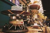 A mockup of the Venera 13 spacecraft is displayed at the Cosmos Pavilion of the Exhibition of the Achievements of the National Economy in Moscow, Russia. The lander module in the foreground would sit inside the brown sphere atop the Venera spacecraft (background).