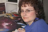 A shot of space artist Lynette Cook at the drawing table.