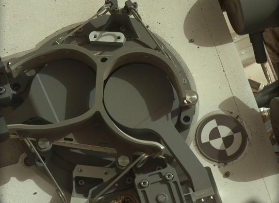 Camera onboard Curiosity shows the covers in place over two sample inlet funnels of the rover's Sample Analysis at Mars (SAM) instrument suite. Curiosity delivered SAM's first soil sample on the day this image was taken, the 93rd Martian day, or sol, of the mission (Nov. 9).