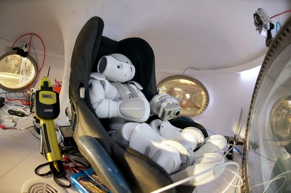 A small humanoid robot made by Aldebaran Robotics got a ride aboard a balloon intended for space tourism on Nov. 9, 2012.