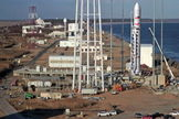 Aerial view of Wallops Island launch site that includes artist concept of Antares rocket on pad.