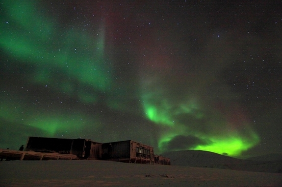 This shows an aurora appearing in the night sky at the Kjell Henriksen Observatory in Svalbard, Norway. Taken November 2010.