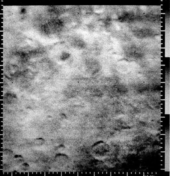 This Mariner 4 image was the first picture showing unambiguous craters on the surface of Mars. The area, 262 by 310 km (162 by 192 miles), is a heavily cratered region south of Amazonis Planitia.