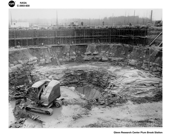 Space History Photo: Crews Excavate A Hole In The Ground
