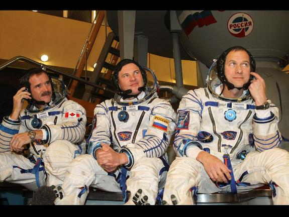 Expedition 34 Flight Engineer Chris Hadfield of the Canadian Space Agency (left), Soyuz Commander Roman Romanenko (center) and NASA Flight Engineer Tom Marshburn (right) are scheduled to launch Dec. 19 from the Baikonur Cosmodrome in Kazakhstan on the Soyuz TMA-07M spacecraft.