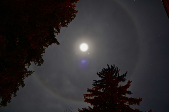 Jupiter shines bright near a halo-wrapped moon in this amazing photo by stargazer Hunter Davis of Durango, Colo., on Dec. 25, 2012.