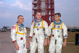 Astronauts (left to right) Gus Grissom, Ed White, and Roger Chaffee posing in front of Launch Complex 34.
