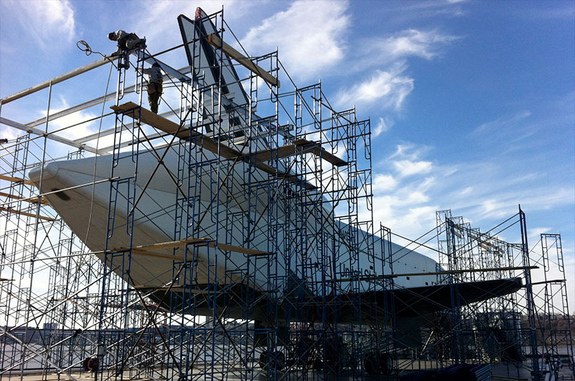 Temporary scaffolding is seen being raised around Enterprise on the flight deck of the Intrepid Sea, Air and Space Museum.