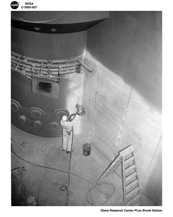 Space History Photo: Worker Spray Paints Quadrant Wall