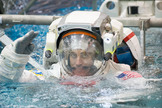 NASA astronaut Chris Cassidy, Expedition 35/36 flight engineer, attired in a training version of his Extravehicular Mobility Unit (EMU) spacesuit, is submerged in the waters of the Neutral Buoyancy Laboratory (NBL) near NASA's Johnson Space Center.
