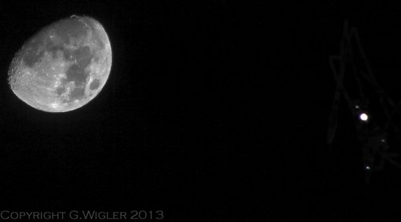 Skywatcher Greg Wigler captured this photo of Jupiter near the moon on Jan. 21, 2013 during an extreme close encounter. The image also shows two Jovian moons and a star.