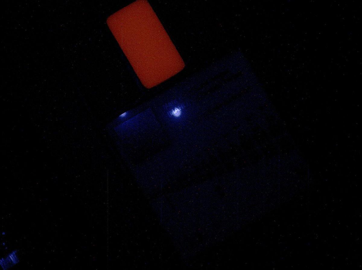 First Night Image of MAHLI Calibration Target Under Ultraviolet Lights