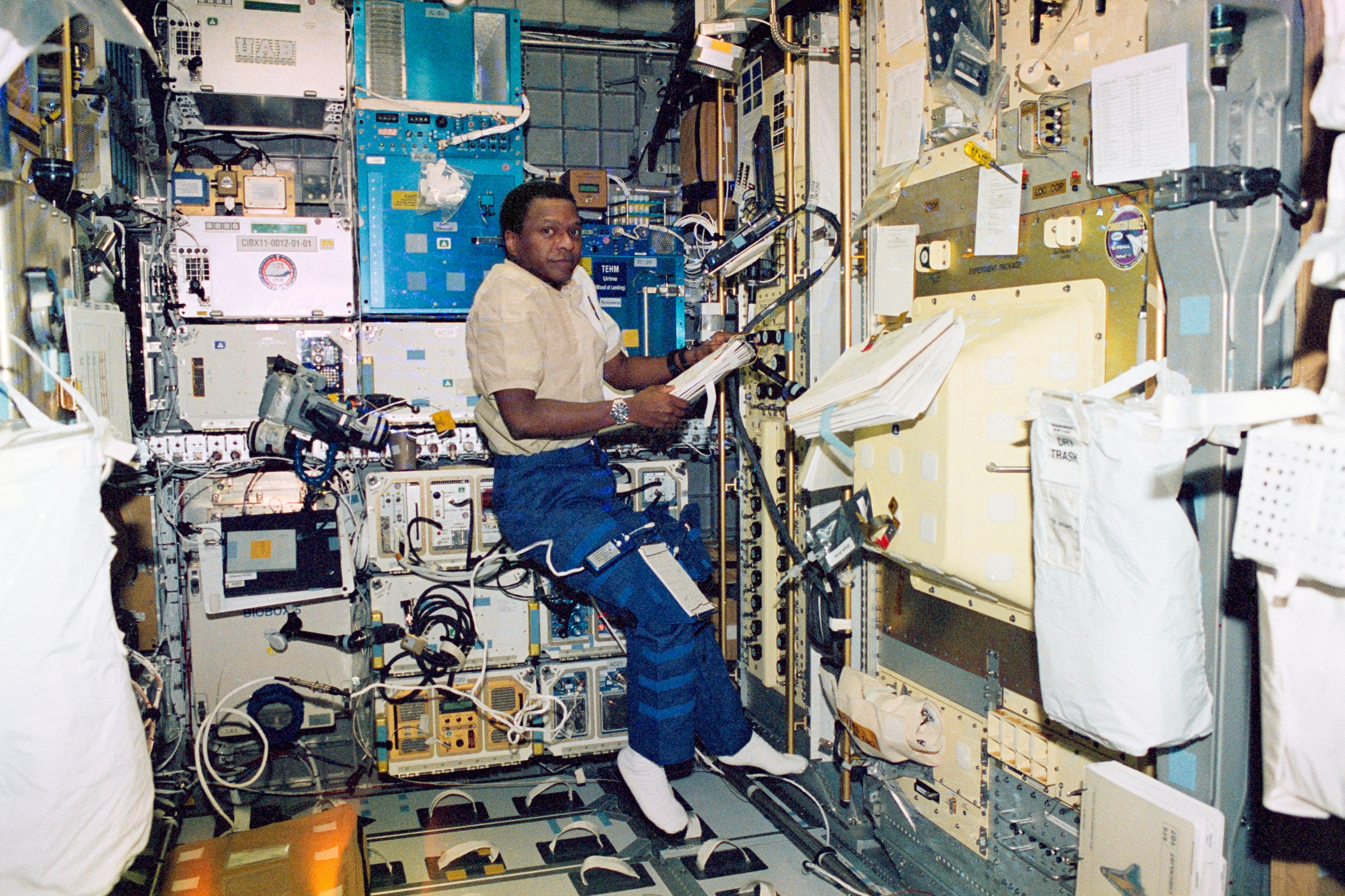 Astronaut Michael Anderson Checking Procedures on STS-107
