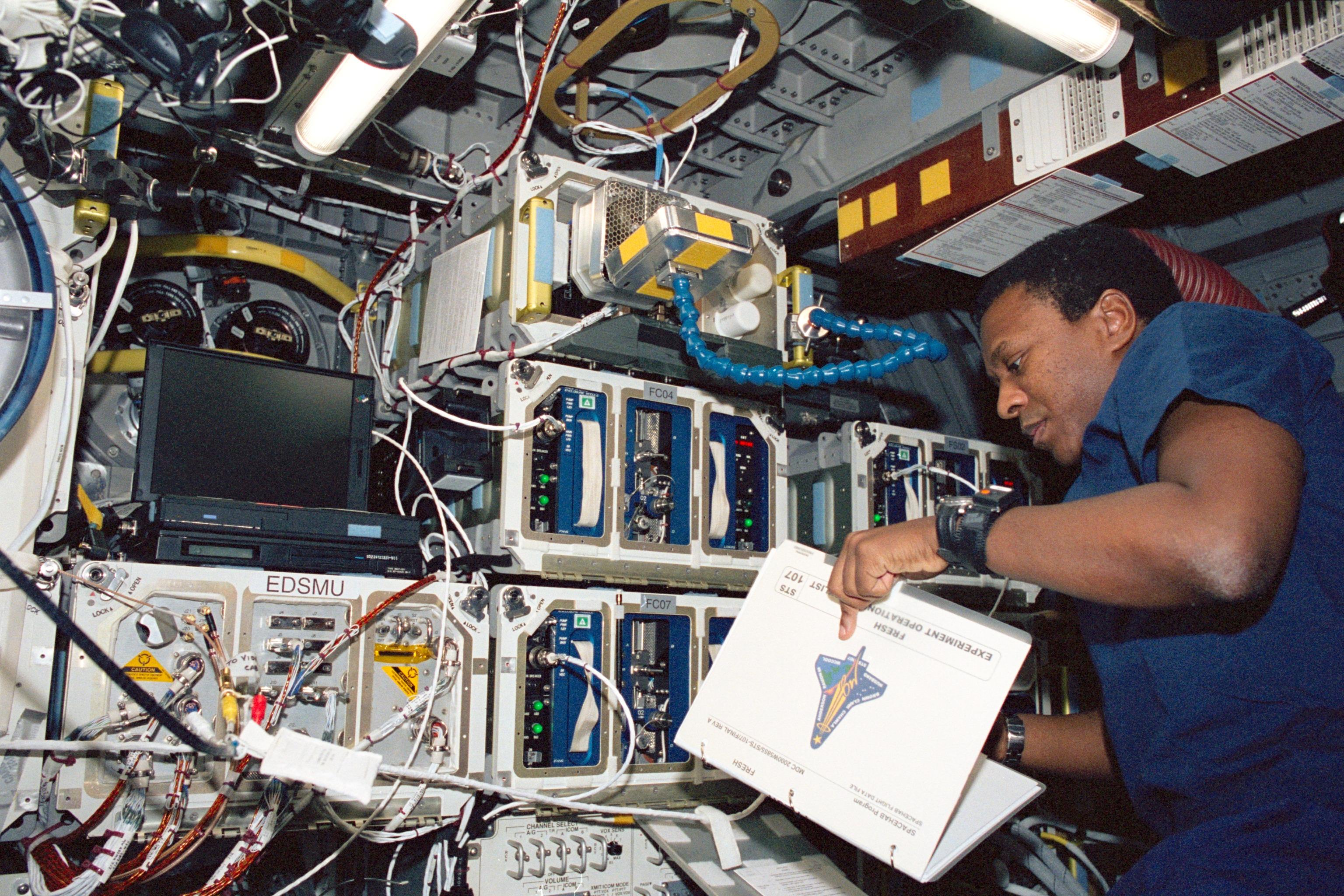 Astronaut Michael Anderson Reads a Checklist