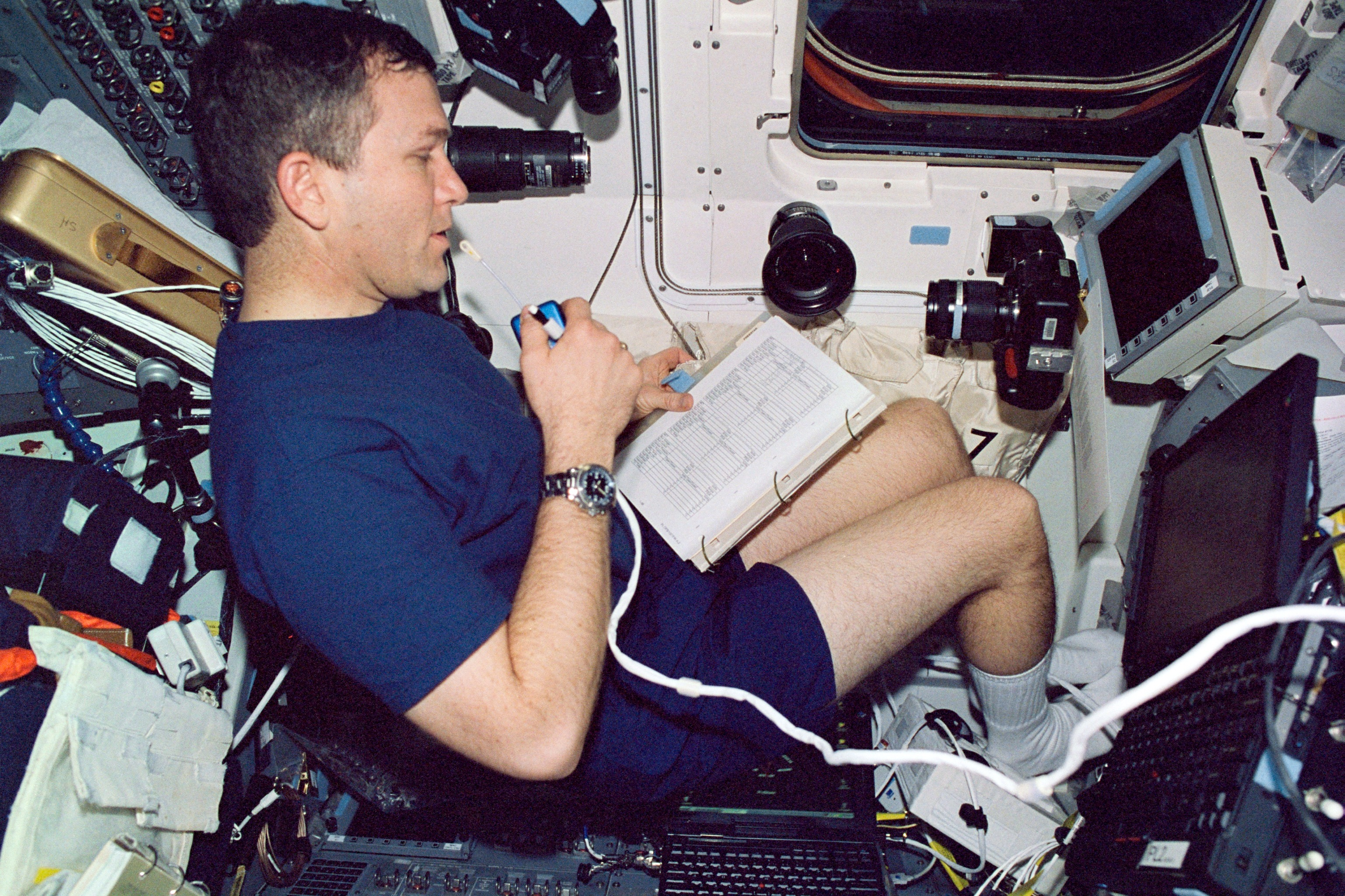 Astronaut Rick Husband on Aft Flight Deck