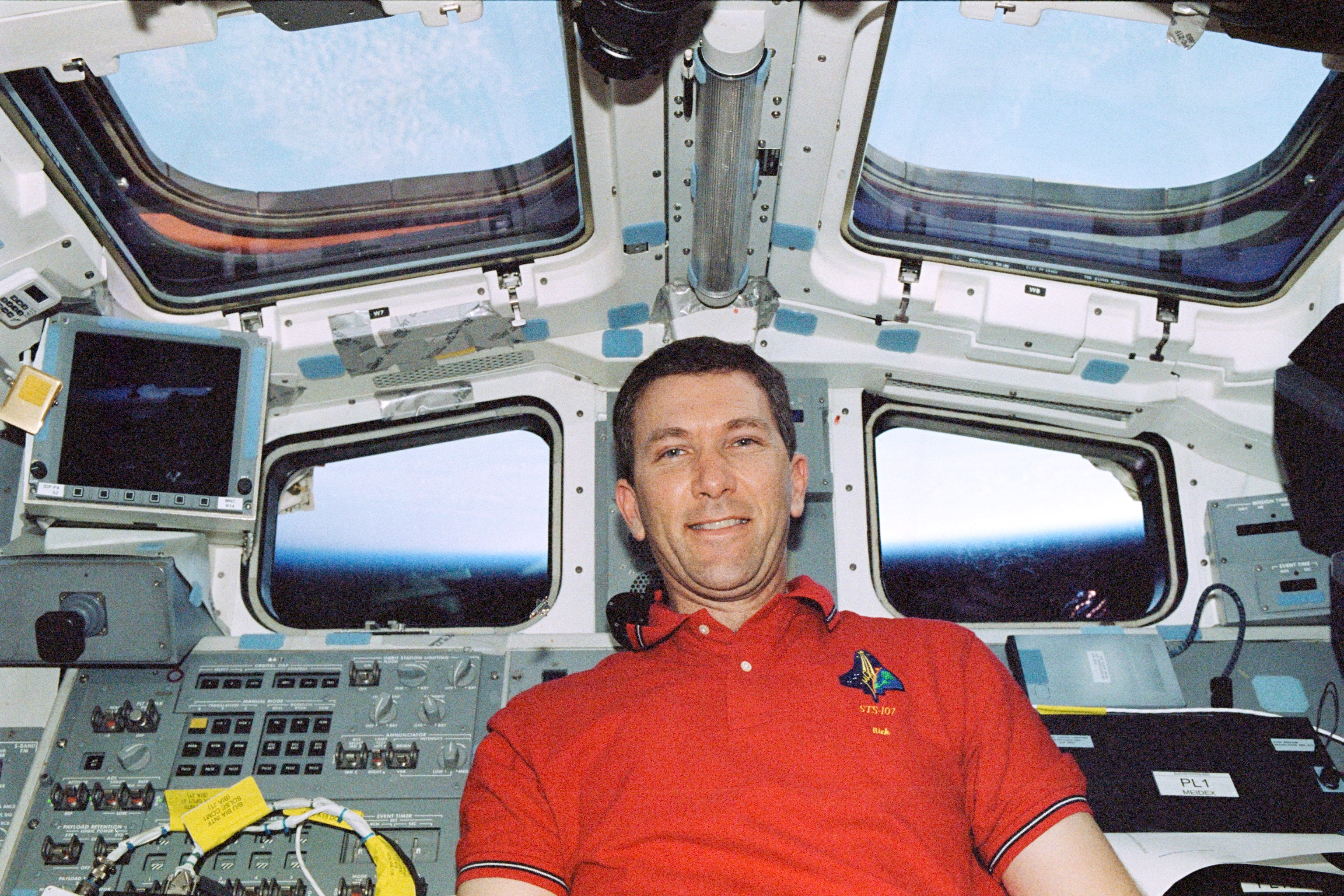 Astronaut Rick Husband Near Control Panels