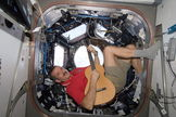 Canadian Space Agency astronaut Chris Hadfield strums his guitar in the International Space Station's Cupola on Dec. 25, 2012. Hadfield is a long-time member of an astronaut band called Max Q.