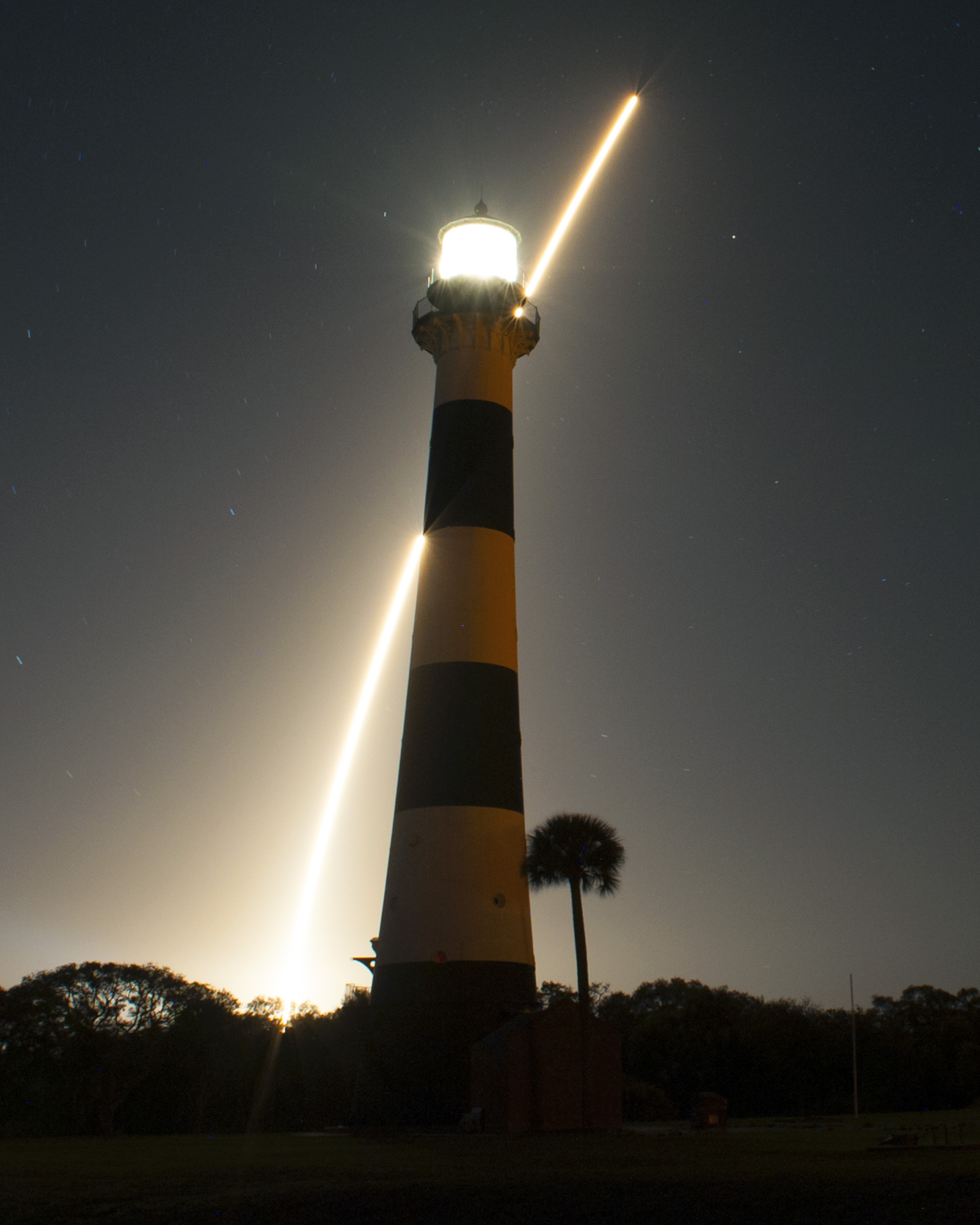 Atlas 5 Rocket Streaks and Lighthouse: TDRS-K Satellite