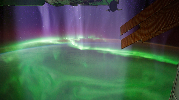 "Visualization of charged particles streaming down onto the atmosphere, creating a stunning aurora as viewed from the International Space Station, as seen in ""Earth From Space,"" a PBS documentary produced by NOVA."