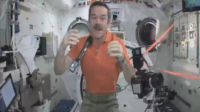 Commander Hadfield With Floating Microphone and Camera