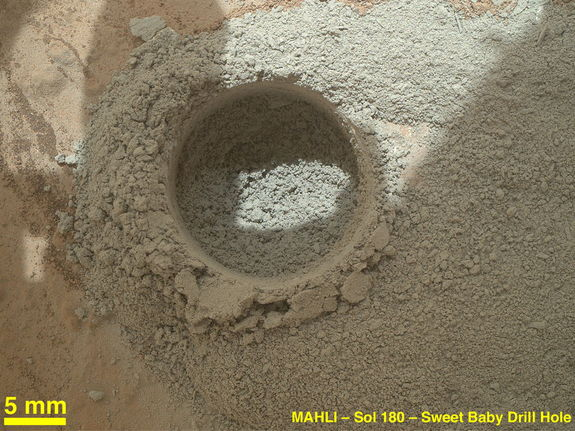 "After an activity called the ""mini drill test"" by NASA's Mars rover Curiosity, the rover's Mars Hand Lens Imager (MAHLI) camera recorded this close-up view of the results during the 180th Martian day, or sol, of the rover's work on Mars (Feb. 6, 2013)."