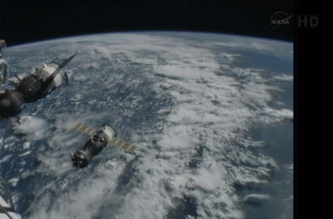 Progress 50 Supply Ship and ISS Above Earth