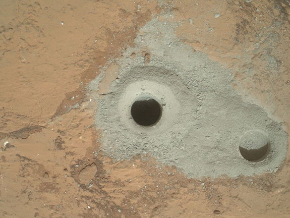 "At the center of this image from NASA's Curiosity rover is the hole in a rock called ""John Klein"" where the rover conducted its first sample drilling on Mars.  The drilling took place on Feb. 8, 2013, or Sol 182, Curiosity's 182nd Martian day of operations."