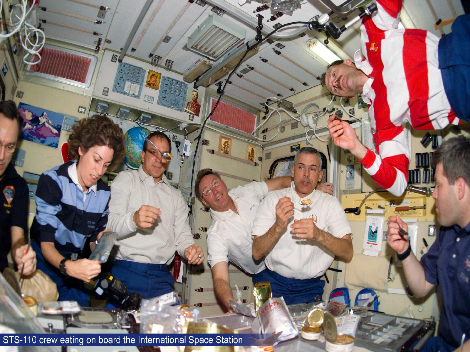 STS-110 Crew Eating on Board ISS